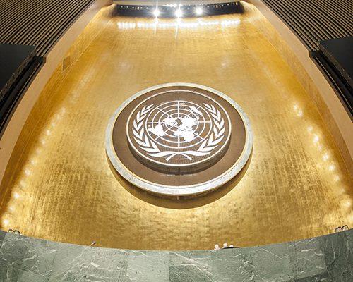 UN emblem and podium in the General Assembly Hall. UN Photo/Cia Pak